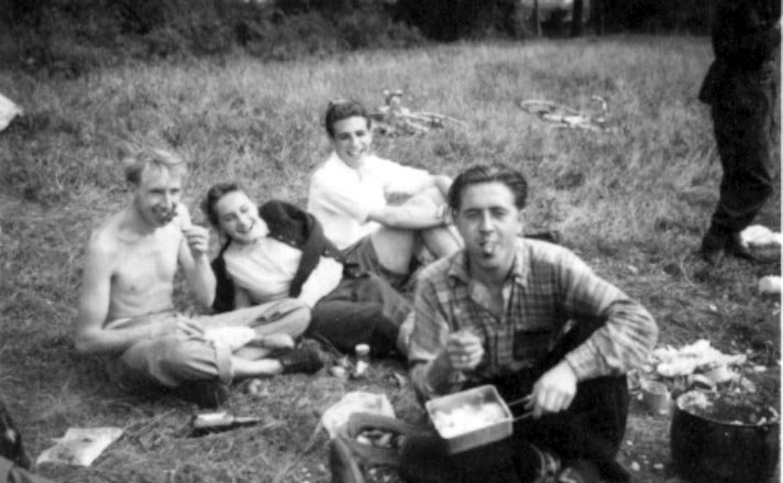 Camping at Bovingdon. Tom and Sheila are on the left; Bob Harvey (right) eats a sausage.